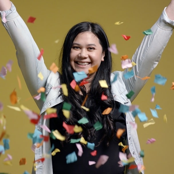 Photo of Dianne Miranda throwing confetti in the air