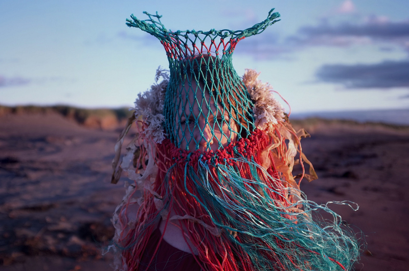 Jordine Cornish, partially obscured by commercial fishing equipment covering head